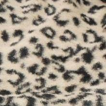 Black snow leopard print on creamy white background faux fur fabric swatch.