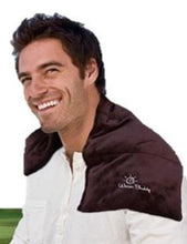 Sports heating pad wrap across man's shoulders - brown velour with Warm Buddy logo