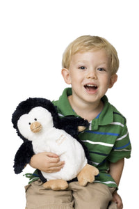 Penguin baby puppet stuffed animal held by blonde haired little boy