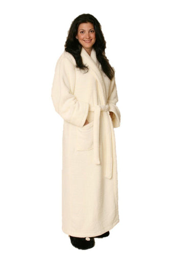 Woman wearing ankle length creamy white robe -front patch pockets shawl collar & matching belt.