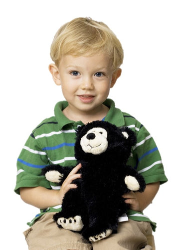 Young boy holding black & white Little Buddy teddy bear