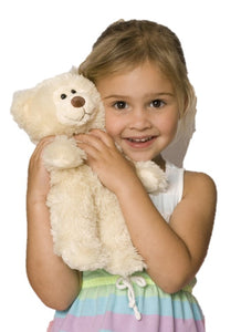 Young girl holding creamy white Little Buddy teddy bear
