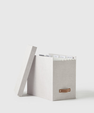 Wear-resistant fiberboard with lid and leather handle.  Metal file channels on the inside designed for letter-size, hanging file folders. Part of The Container Store x KonMari exclusive Joyful Collection created by Marie Kondo.