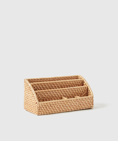 The Container Store x KonMari exclusive Ori Woven Collection designed by Marie Kondo. Desktop organization and office organizers to keep your work from home space tidy. Made of natural woven rattan with storage compartments.