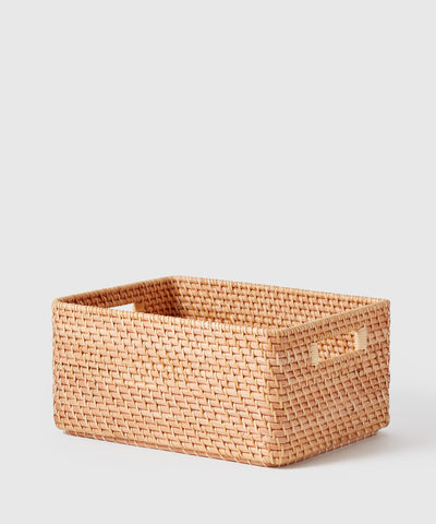 Large woven rattan storage bin with handles. The Container Store x KonMari Ori Woven Collection exclusively designed by Marie Kondo.