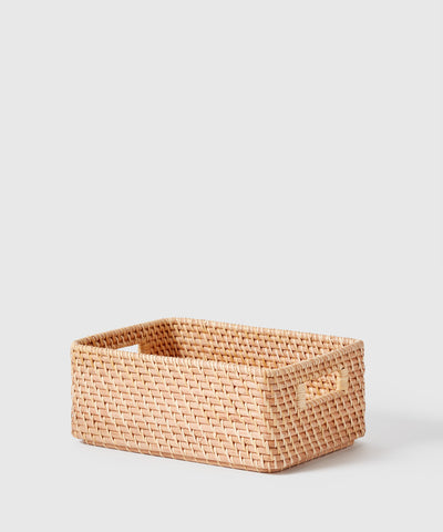 Rattan storage bin with handles. Part of The Container Store x KonMari Ori Woven Collection exclusively designed by Marie Kondo.