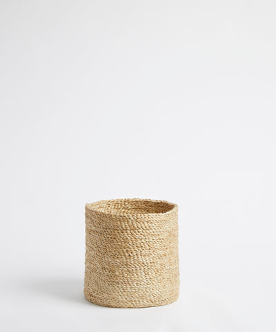 Small jute basket in natural.