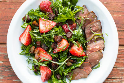 GRILLED BEEF HEART STEAK WITH SMOKED STRAWBERRIES AND BACON-WILTED SPINACH
