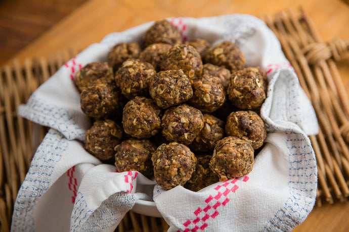 basket of energy balls made with house made peanut butter, oats, unsweetened coconut, ground flax seed, chia seed, and dark chocolate.