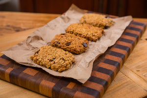 Plate of granola bars. All whole ingredients using homemade peanut butter, raw oats, local honey and a variety of add ins including dried cherries, raisins, almonds and dark chocolate chips.
