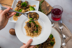Bowl of A healthy version of a classic comfort food, using coconut milk for creaminess, and all whole food ingredients with fresh onions, mushrooms, broccoli, quinoa, and of course beef.