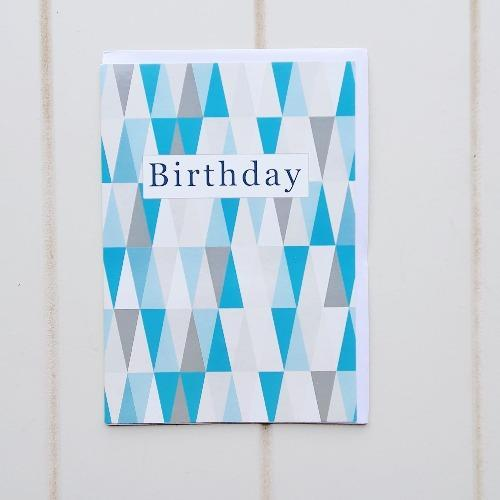 "Birthday Turquoise Triangles Greeting Card. Enjoy giving someone special this tall geometric triangular birthday card. Inside of the card says ""Cheers to you"". Perfect for anyone of any age especially when the card is accompanied with a gift from our online store. 