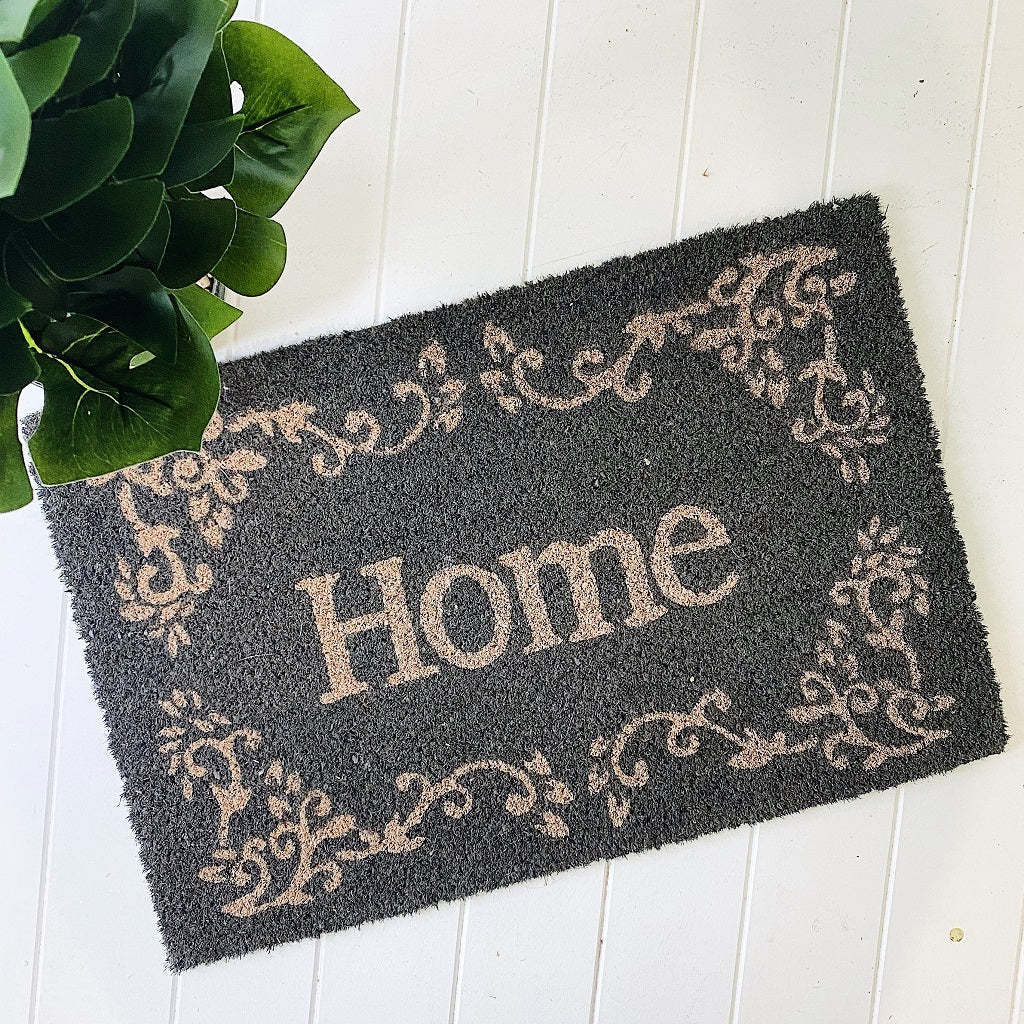 Style your front entrance, the first impression of your home, with our range of affordable door mats. Home with an embellished Border on grey background. Standard size Coir mat. PVC backing W40xL60xH1.5cm. Shop online or instore. AfterPay available. Australia wide Shipping. | Bliss Gifts & Homewares | Unit 8, 259 Princes Hwy Ulladulla | South Coast NSW | 0427795959, 44541523
