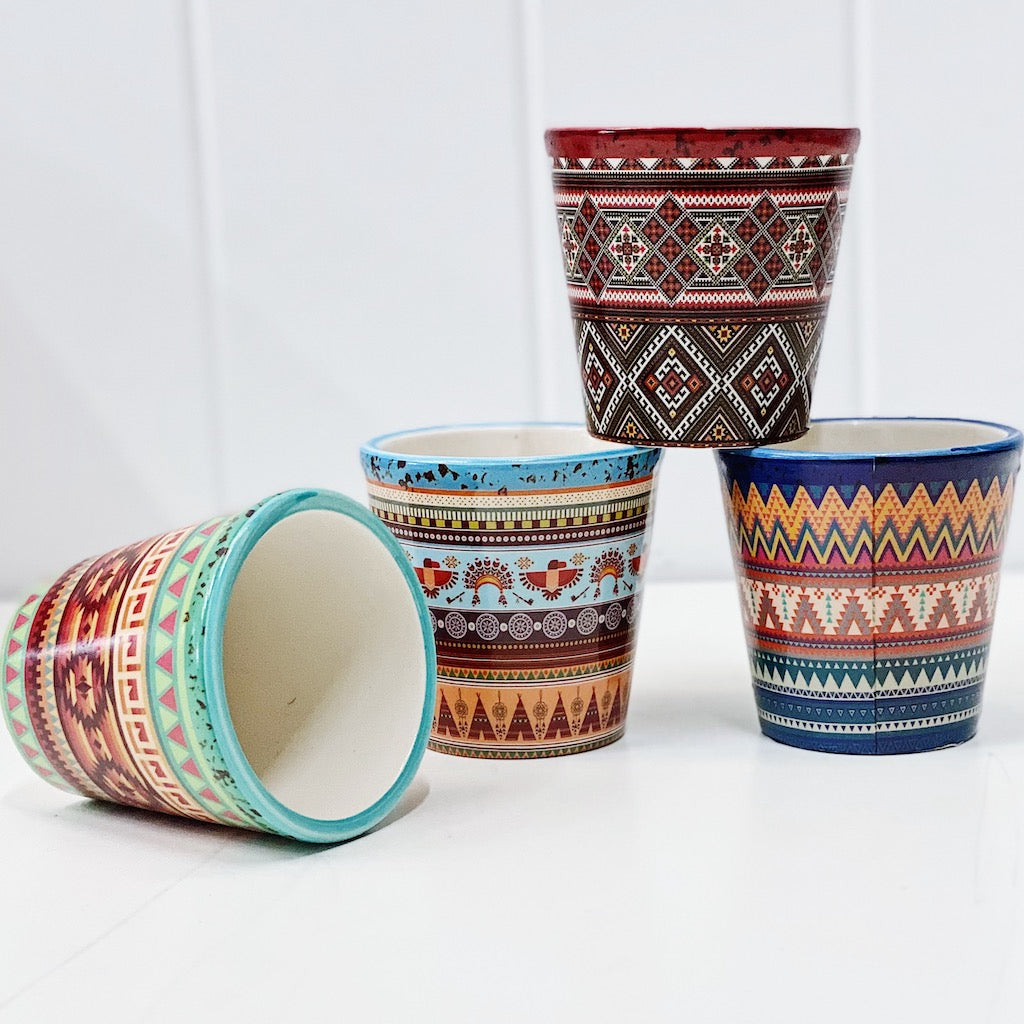 Our gorgeous Inca Aztec Pots in small create a unique style with bold shapes and bright shades of blues, reds and browns. Drainage hole and plug perfect for indoor and outdoor use. Available in 4 styles Measures: 7.2x7.2x7cm. Ceramic.| Bliss Gifts & Homewares | Unit 8, 259 Princes Hwy Ulladulla | South Coast NSW | Online Retail Gift & Homeware Shopping | 0427795959, 44541523