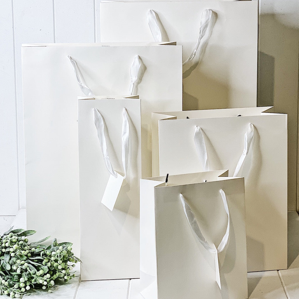 Give your loved ones a gift with our Matte White Gift Bag in Jumbo. Available in multiple sizes to fit your gift perfectly. 35x53x14cm.| Bliss Gifts & Homewares | Unit 8, 259 Princes Hwy Ulladulla | South Coast NSW | Online Retail Gift & Homeware Shopping | 0427795959, 44541523
