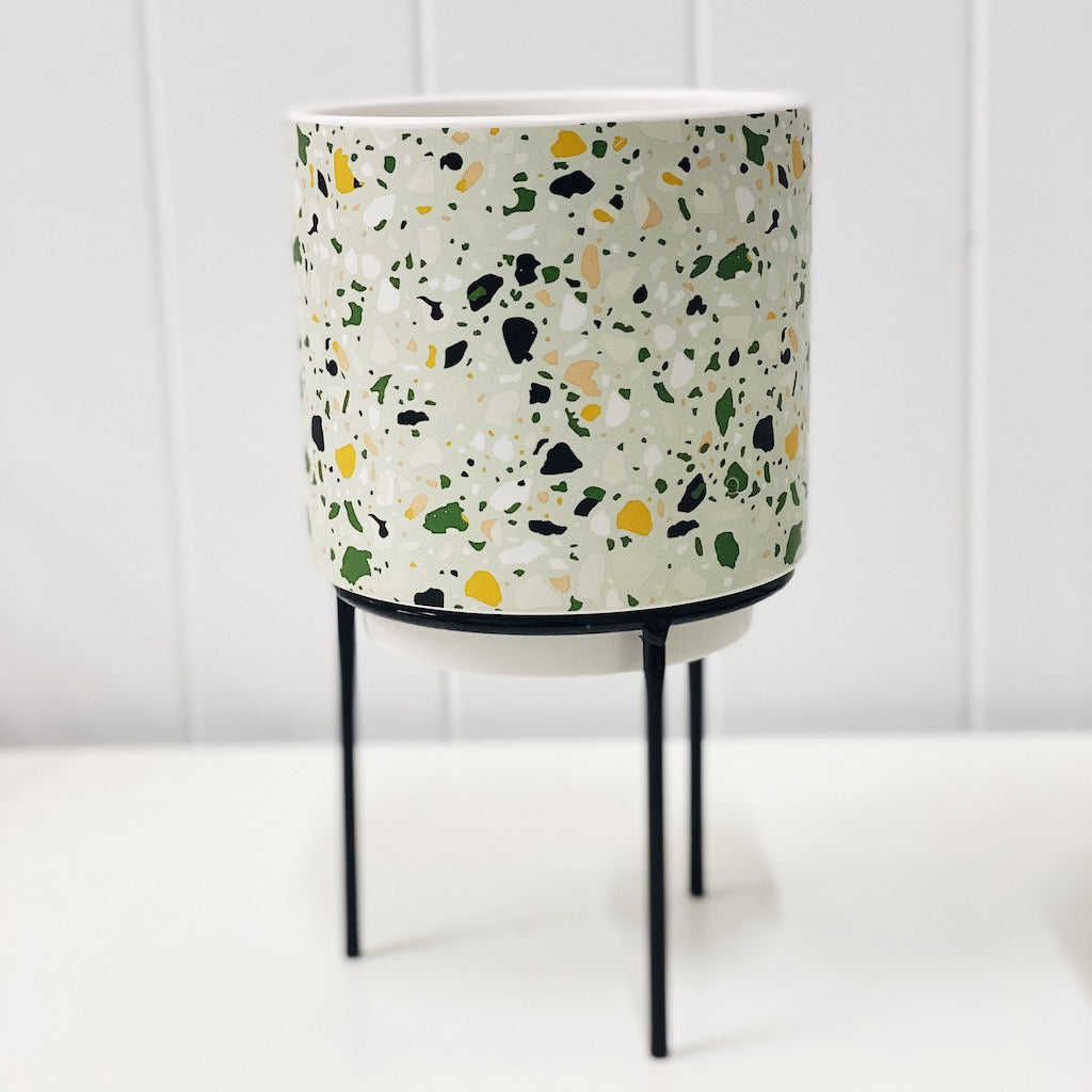 Showcase your favourite plants, succulents, and flowers with the beautiful and unique Terrazzo Pots on Stand in Small. Approx size: 14x14x14.3cm. Ceramic. Drainage hole and plug for your convenience. Shop Online & In-store. AfterPay Available. Australia Wide Shipping | Bliss Gifts & Homewares | Unit 8, 259 Princes Hwy Ulladulla | South Coast NSW | 0427795959, 44541523