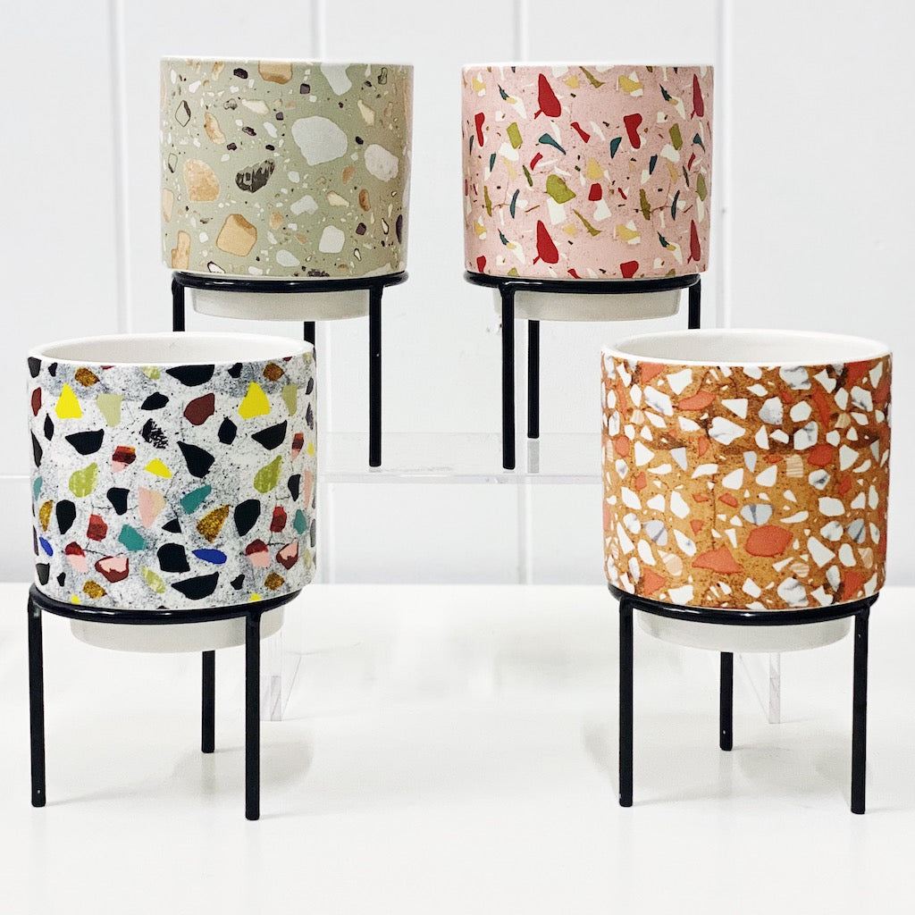 Showcase your favourite plants, succulents, and flowers with the beautiful and unique Terrazzo Pots on Stand in Small. Approx size: 10x10x10cm. Ceramic. Drainage hole and plug for your convenience.| Bliss Gifts & Homewares | Unit 8, 259 Princes Hwy Ulladulla | South Coast NSW | Online Retail Gift & Homeware Shopping | 0427795959, 44541523