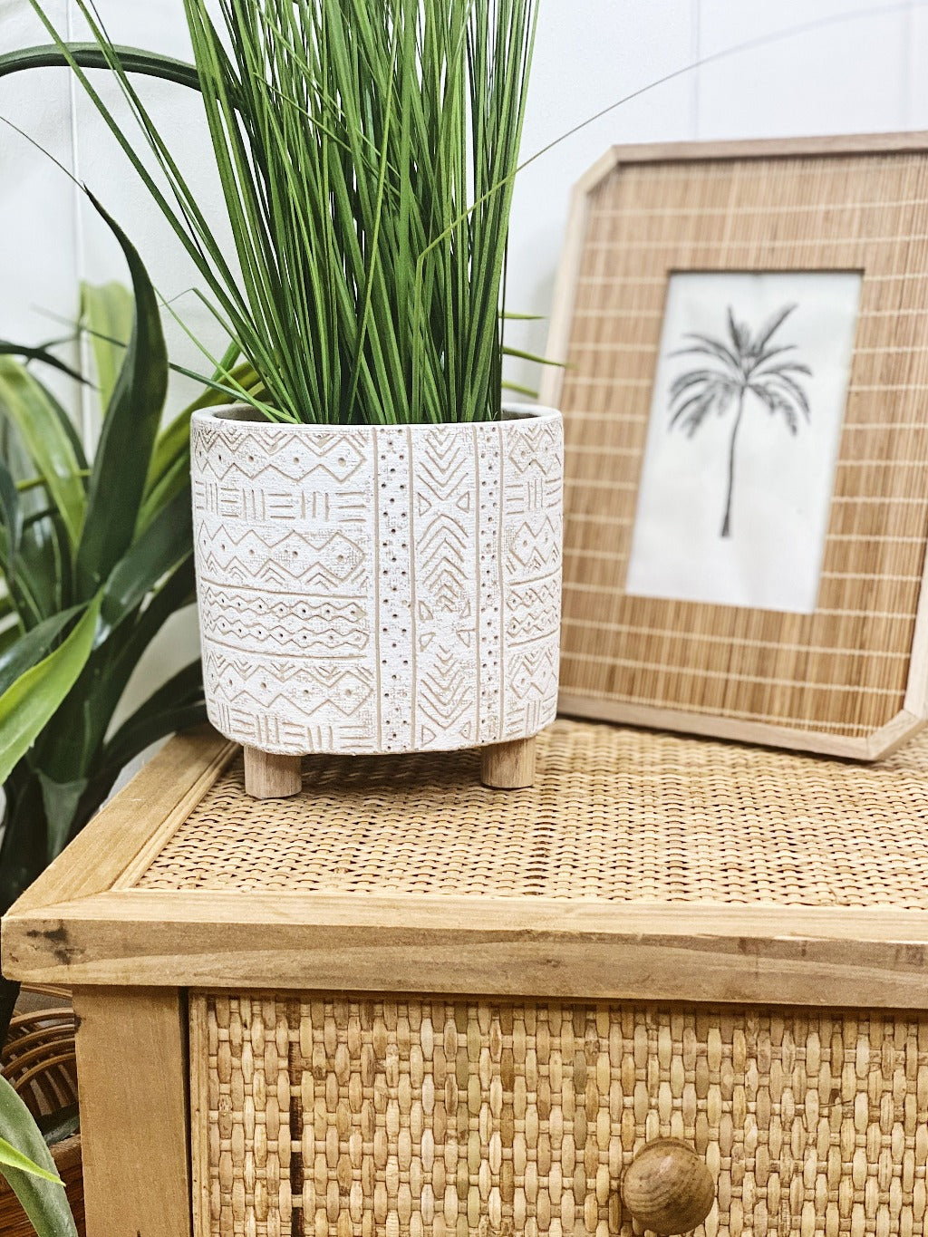 Add style to your plants and home with our White Tribal Pots. The neutral tones will compliment any home, and the textured finish will add a modern touch. Drainage hole, suitable for indoor and outdoor use. 14x14x14cm. Terracotta and timber legs.| Bliss Gifts & Homewares | Unit 8, 259 Princes Hwy Ulladulla | South Coast NSW | Online Retail Gift & Homeware Shopping | 0427795959, 44541523
