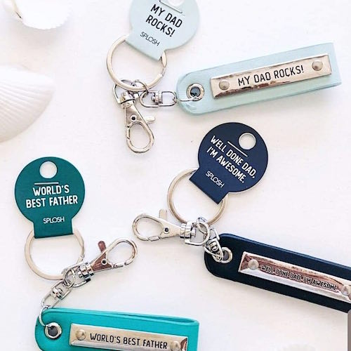 "Designed in bright pops of colour, featuring bold patterns and shades of humour with the playful cheekiness that your Dad will love, put a smile on his face this Father's Day, Christmas or Birthday with a sentimental key chain! Engraved quote ""My Dad Rocks!""