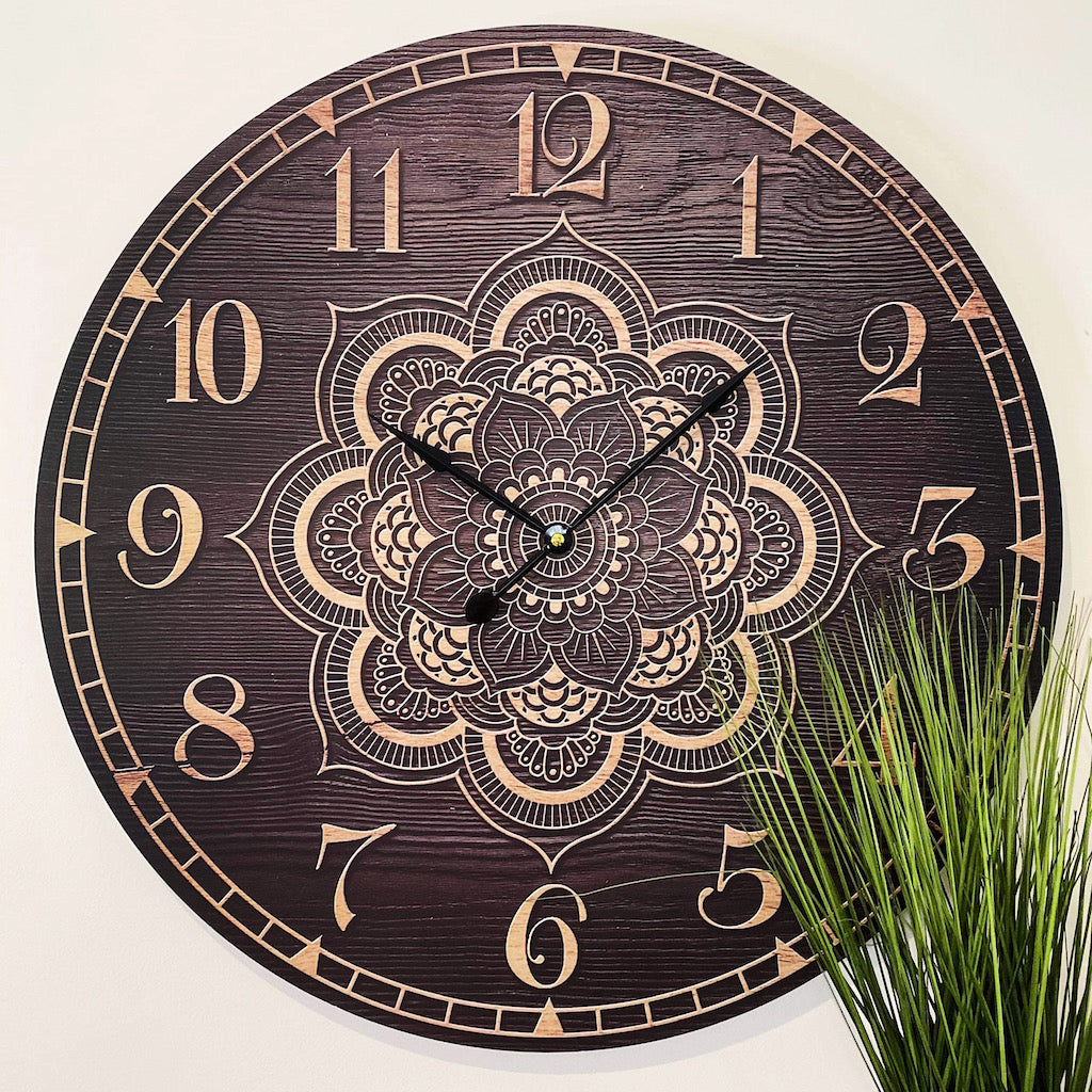 Full of style and character, our Timber Mandala Clock Clock is a beautiful statement clock. Perfect for your home or an office space, the large 58cm clock makes an impact. Features traditional numerals for easy reading at a distance.| Bliss Gifts & Homewares | Unit 8, 259 Princes Hwy Ulladulla | South Coast NSW | Online Retail Gift & Homeware Shopping | 0427795959, 44541523