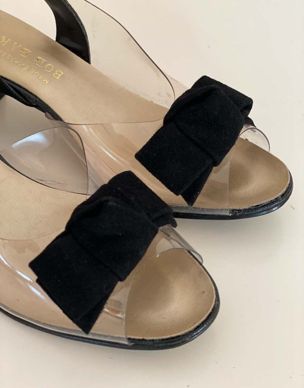 Clear shoe with black velvet bow
