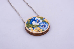 Necklace made with colorful fabric on light wood base