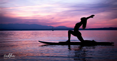 Yoga pose on a SUP paddle board
