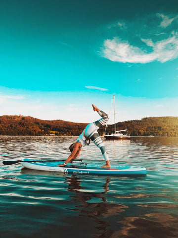 Woman doing core exercises on a paddle board