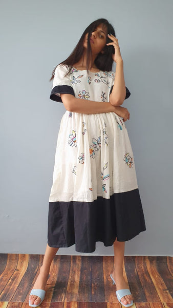Unfinished flowers midi dress