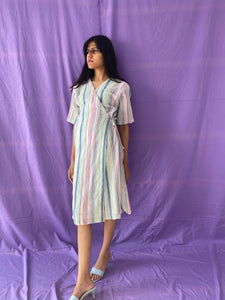 Wrapped in pastel dress