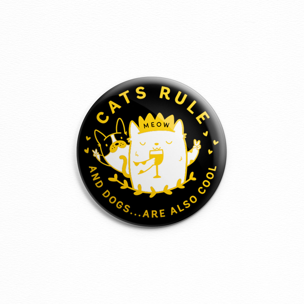 Cats Rule - Button or magnet with an illustration of a cat wearing a crown and drinking wine in front of a dog.