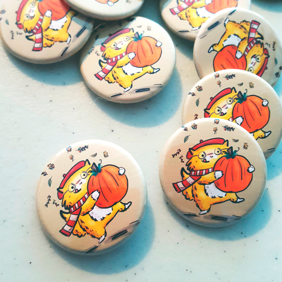 Pumpkin Cat ~ Autumnal pinback button or ceramic magnet of a ginger kitty holding a pumpkin by My Cat Is People