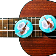 Ukulele Cat - Button or magnet with a digital painting of a cat playing the ukulele and singing by My Cat Is People.