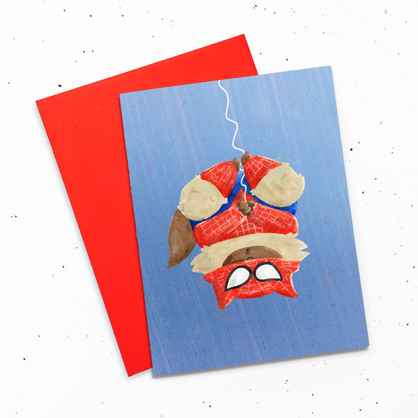 Spider-Cat - Greeting card with a digital painting of a cat hanging upside down from a web like Spider-Man, waiting for a kiss.