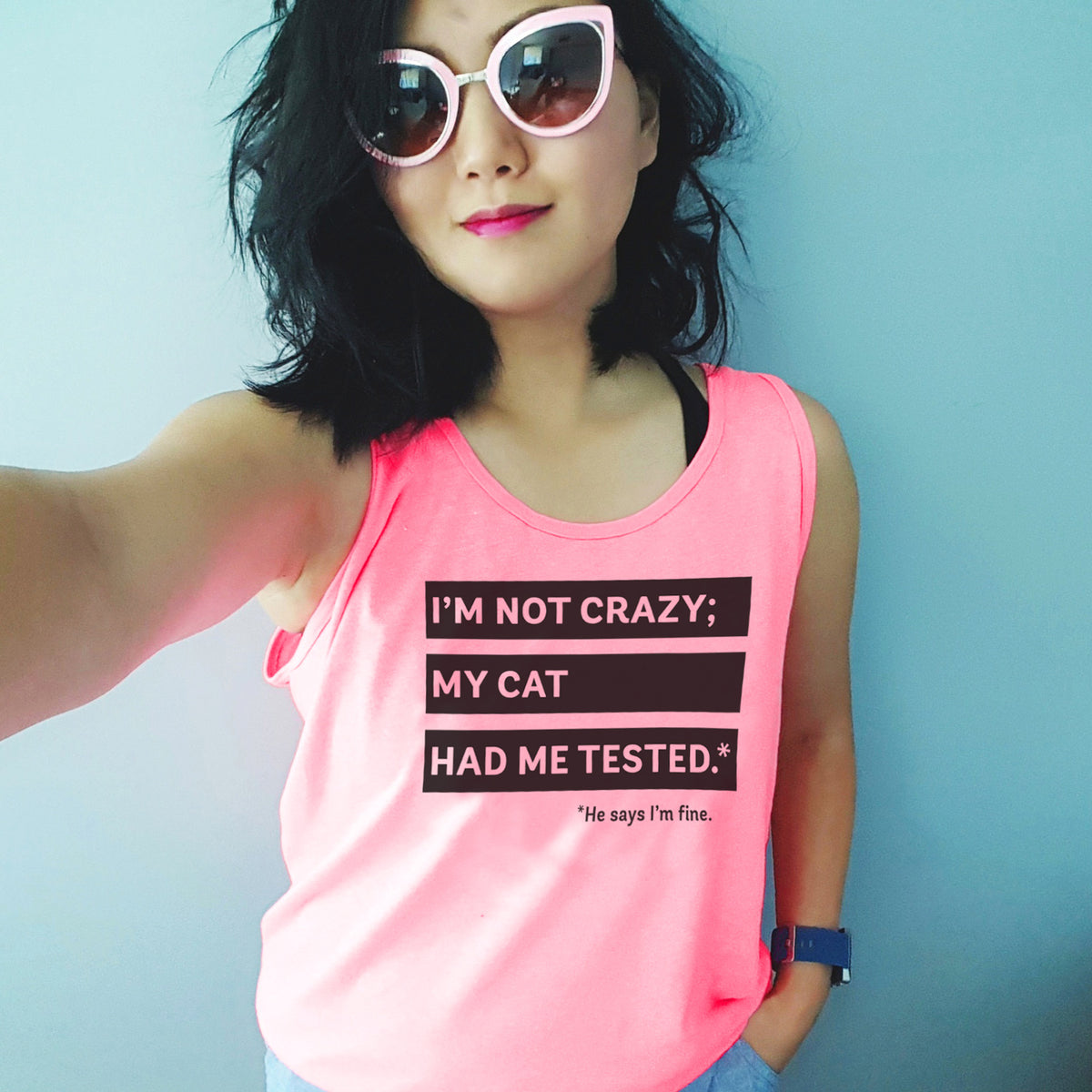 I'm Not Crazy; My Cat Had Me Tested. He Says I'm Fine. - Screen printed neon pink unisex tank top for totally normal cat people.