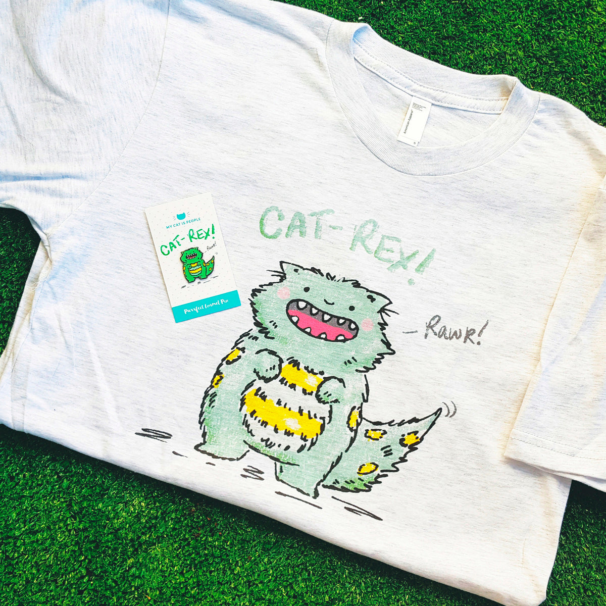 Cat Rex - Direct-to-garment printed t-shirt. Half munchkin cat, had t-rex dinosaur. Rawr!