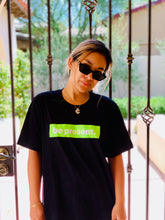 """BE PRESENT"" Neon Lime Green Classic Logo Unisex Black Tee. Vibrate your Be. ""be prese [Unisex Size Fits]  Women: One Size (equivalent to Men size Large)   **  Styling Tips:  Front tie-twist crop top &/or T-shirt dress  Color: Black  Logo: Neon Lime Green"
