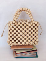 Cream wooden beaded Twin handle bag