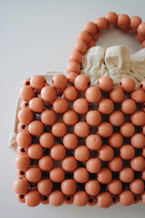 Peachy Twin Handle Beaded Bag