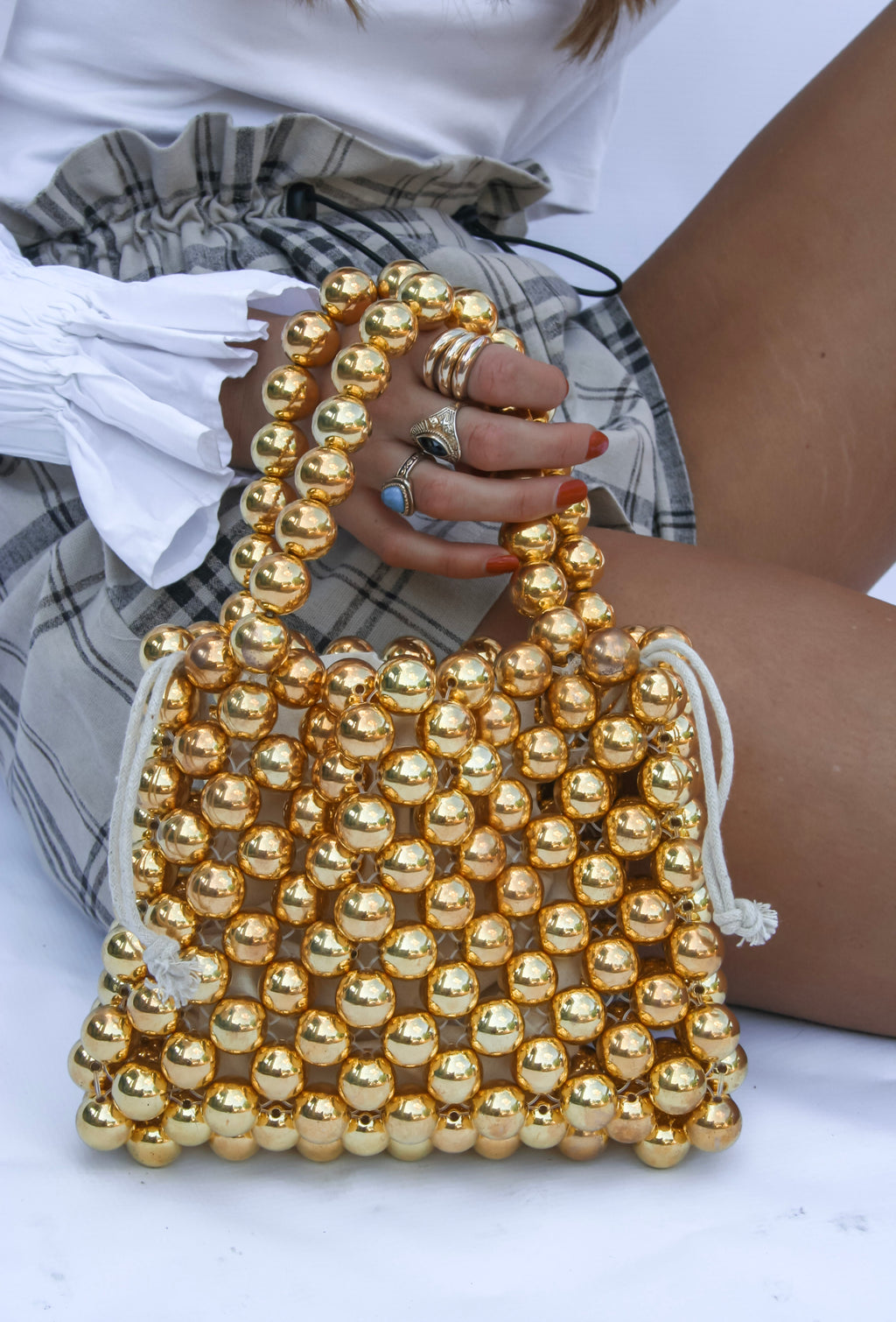 Golden Gates twin handle beaded bag