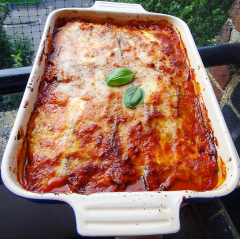 Healthy aubergine parmigiana topped with basil