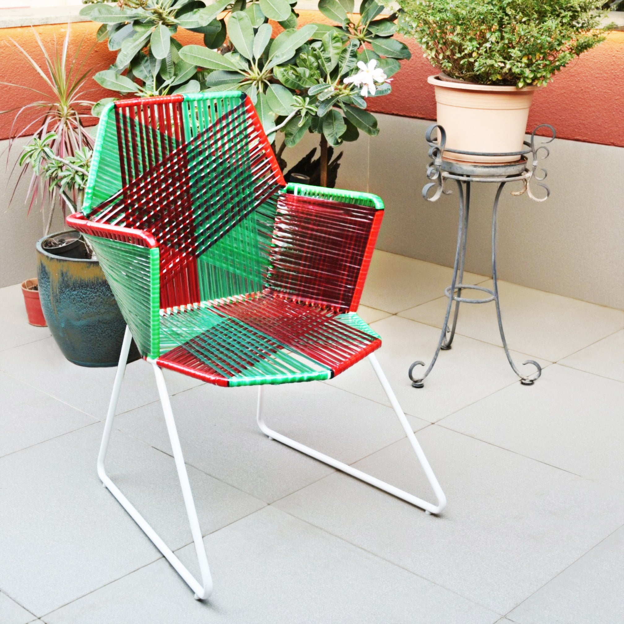 1 BHK Interiors Psychedelic Metal & Plastic Cane Outdoor Garden Chair in Red & Green with White Frame