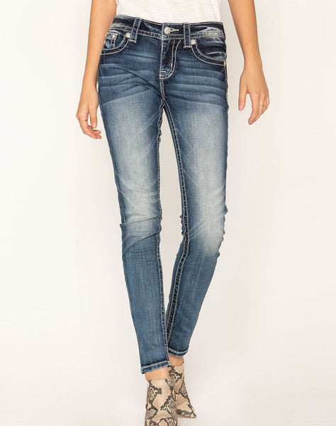 FEATHERED OUT SKINNY JEANS