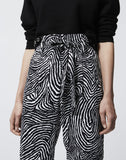 Flowing printed trousers with knotted waist