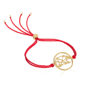 Daisy London x Ellie Goulding red cord bracelet.