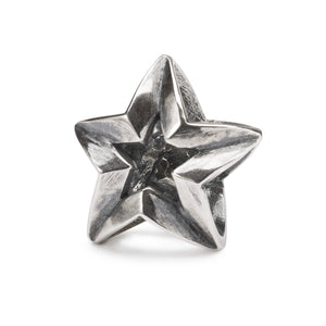 A star shaped silver bead, a collectable bead for a charm bracelet or necklace, back view