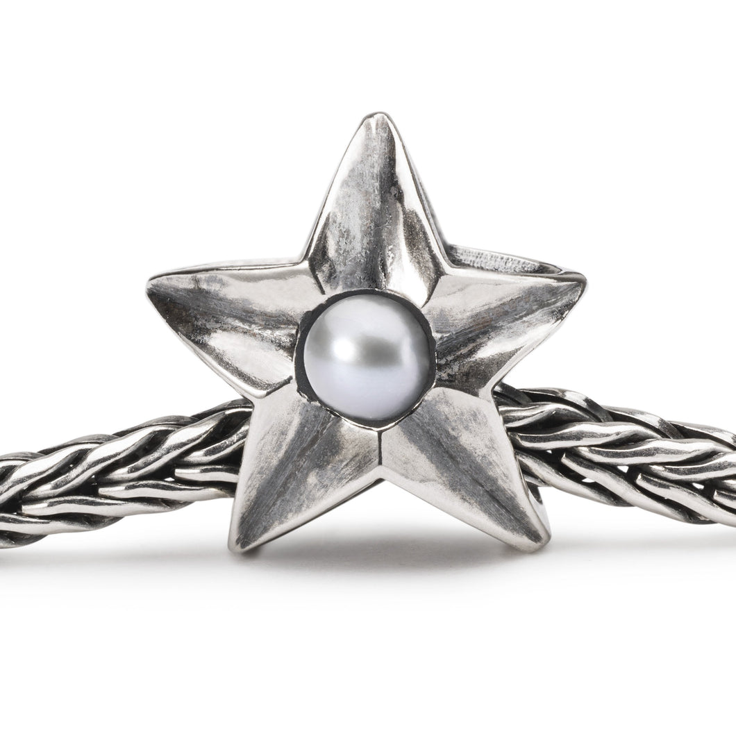 A star shaped silver bead, a collectable bead for a charm bracelet or necklace, on chain