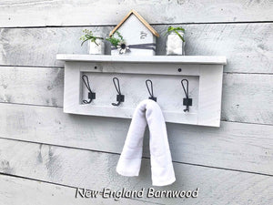 whitewashed bathroom shelf with hooks