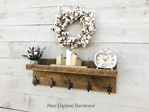 rustic bathroom shelf with towel hooks