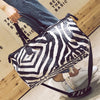 Image of Zebra Crossbody Duffel Bag